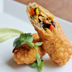 Southwestern Egg Rolls Recipe - An assortment of traditional Southwestern-style ingredients are wrapped inside small flour tortillas and deep fried.