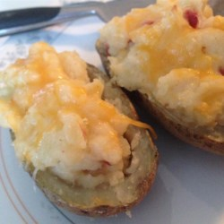 Twice Baked Potatoes Recipe - This is great as a side dish or as an appetizer. Melted cheese and crumbled bacon are the highlights of the flavorful, creamy filling.