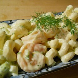 Grandma Bellows' Lemony Shrimp Macaroni Salad with Herbs Recipe - A light, lemony shrimp and pasta salad to be served cold has a pretty garnish of sliced hard-cooked eggs on top. It's Grandmother's time-tested recipe.