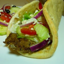 Traditional Gyro Meat Recipe - This Greek/Lebanese style meat loaf is sliced and served with pita bread, tzatziki, and tomatoes for a delicious gyro that is the closest I've come to emulating my favorite Mediterranean restaurant.  The preparation time seems long, but most of it is resting time, so you can be doing other stuff!