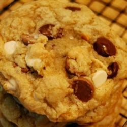 Quadruple Chocolate Chip Cookies Recipe - Kick up your chocolate chip cookies with these quadruple chocolate chip cookies packed with white, milk, semisweet, and peanut butter chocolate chips!