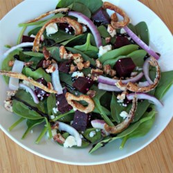 Spinach and Beet Salad Recipe - Spinach and roasted beets are tossed with candied walnuts, goat cheese, and a homemade vinaigrette for a lovely summer salad perfect for weeknights.