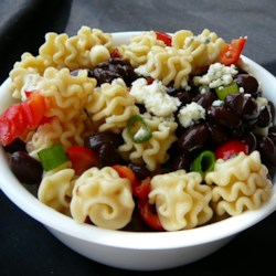 Spicy Pasta Salad Recipe - Sun dried tomatoes and feta cheese are an irresistible combination, and they work deliciously in this pasta salad. Serve chilled with a tasty Italian dressing.