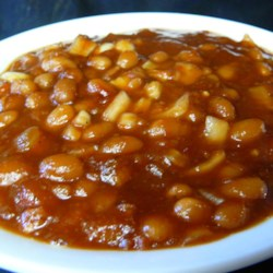 Down Home Baked Beans Recipe - Chili sauce is the secret ingredient in these beans baked with bacon, onion and brown sugar.  This recipe can also be prepared in a slow cooker, if desired.