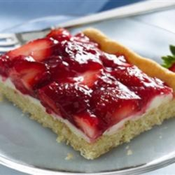 Creamy Strawberry Dessert Squares Recipe - Strawberry dessert squares with a cream cheese layer and sugar cookie crust are a creamy and colorful dessert for any occasion.