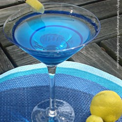 Electric Lightning Recipe - The blue Curacao liqueur gives a summery color to this simple cocktail with coconut rum and vodka.