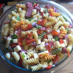 Pasta Deli Salad Recipe - A flavorful combination of meats, cheeses, and vegetables tossed with pasta and dressing.