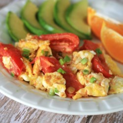 Tomato and Egg Stir Fry Recipe - This tomato and egg stir fry cooked in avocado oil is a quick and easy breakfast and falls nicely into the paleo lifestyle.