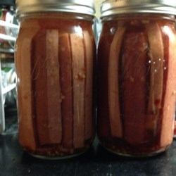 Pickled Sausage Recipe - A convenience store treat that you can make in your own home. Cooked smoked sausage is pickled in a red brine for an irresistible indulgence.