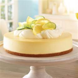 Lemon-Lime Cheesecake Recipe - Fresh lemon and lime zest and juice flavour a classic cheesecake with a graham crust.