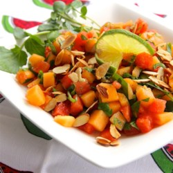 Watercress, Melon and Almond Salad Recipe - Cantaloupe and watermelon cubes are added to chopped watercress and dressed with a sweetened vinaigrette made with lime juice and a bit of fresh, minced ginger. Toasted almonds are sprinkled on before serving.