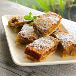 Mango Squares Recipe - Everyone will enjoy these tasty mango dessert squares dusted with powdered sugar!