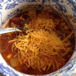 Texas Cowboy Stew Recipe - Ground beef, link sausage, cumin, chilies, and chili powder give this hearty soup its Southwest flavor. This dish is quick, easy, and tastes best when it simmers all day. Bake some Mexican cornbread, toss a simple green salad, and you have a great meal.