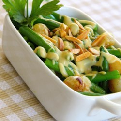 Green Beans With Mustard Cream Sauce and Toasted Almonds Recipe - Green Beans With Mustard Cream Sauce and Toasted Almonds is my answer to classic green bean casserole. The vegetables and sauce can be made in the morning. Before serving, heat them together and sprinkle with almonds.
