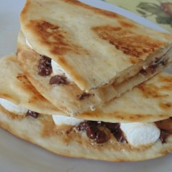 Dessert Quesadillas with Peanut Butter, Chocolate, and Marshmallow Recipe - These sweet quesadillas are filled with peanut butter, chocolate, and marshmallow for a fun dessert after a Mexican-themed dinner.