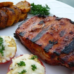 Smoky Grilled Pork Chops Recipe and Video - Pork chops are given a smoky, spicy rub, then grilled to tenderness for a main dish in under 1 hour.