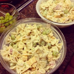 Allison's Pasta Salad Recipe - This salad has it all: cooked ham, fresh grapes, Cheddar cheese, and a rich dill dressing. Use your favorite pasta shape to make this salad your own.