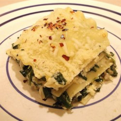 Spinach Mushroom Lasagna Recipe - Spinach and fresh mushrooms fill this meat-free lasagna. Cottage cheese and ricotta cheese add a rich and creamy texture.