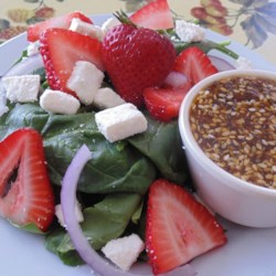 Spinach and Strawberry Salad with Feta Cheese Recipe - Spinach salad with strawberries is a summertime natural. This version adds feta cheese and provides a homemade balsamic vinaigrette.