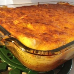 Classic Hamburger Pie Recipe - Cooked ground beef topped with mashed potatoes and Cheddar cheese is a classic comfort food dish to please the entire family.
