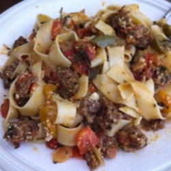 Italian Drunken Noodles Recipe - This quick and easy pasta dish features a flavorful tomato sauce to go with spicy Italian sausage.