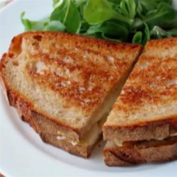 Grilled Brie and Pear Sandwich Recipe - Chef John's grilled Brie and pear sandwich is an fresh and delicious twist on traditional grilled cheese.
