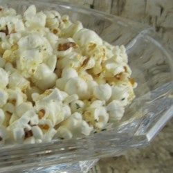 Garlic Bread Popcorn Recipe - Popcorn coated in butter, Parmesan cheese, and garlic salt has all the flavors of garlic bread in the form of a tasty snack.