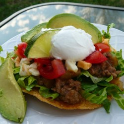 Chipotle Beef Tostadas Recipe - Tostadas are layered with spicy chipotle beef, sour cream, and shredded cheese for a flavorful and Mexican-inspired meal.