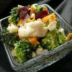 Bop's Broccoli Cauliflower Salad Recipe - This addicting broccoli cauliflower salad featuring bacon and cheese is a hit at parties and gatherings.