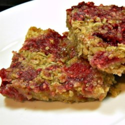 Raspberry Applesauce Squares Recipe - A sweet raspberry and applesauce filling surrounded by buttery oats makes a delightful snack for tea time with this quick and easy recipe.