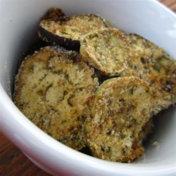 Eggplant Chips Recipe - Eggplant strips are coated with Romano cheese, garlic, parsley, oregano, salt and pepper and baked until crispy.  What a great snack!