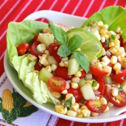 Easy Cherry Tomato Corn Salad Recipe - In the summer use fresh corn corn off the cob and tomatoes from your garden in this simple and delicious tomato corn salad.