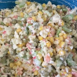 Crab and Pea Salad Recipe - A salad made with imitation crab, peas and bacon. Great for summer barbeques.