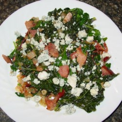 Kale and Chard Supreme Recipe - Kale and chard are pan-fried with ham and pineapple and then tossed with feta cheese, almonds, and dried cranberries for a colorfully delicious side dish.