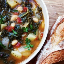 Vegetarian Kale Soup Recipe and Video - This wonderful soup will warm your insides, delight your taste buds, and fill your stomach on a cold winter's night. It is full of dark green kale, potatoes, and cannellini beans.