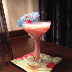 Pink Lady Cocktail Recipe - Popular in the 1950s, this cocktail contains gin and grenadine. Make sure you serve it in a pretty glass!