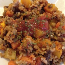 Lentil Rice and Veggie Bake Recipe - Lentils, rice, tomato sauce, herbs, and vegetables yield a wonderful meal for vegans and non-vegans alike.
