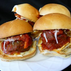 Mini Meatball Subs Recipe - Tiny meatball subs with red sauce and mozzarella cheese are perfect for entertaining.