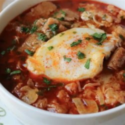 Chef John's Spanish Garlic Soup (Sopa de Ajo) Recipe - Chef John's recipe for sopa de ajo, Spanish garlic soup, is a rustic bread soup spiked with garlic, paprika, ham, and topped with a poached egg.