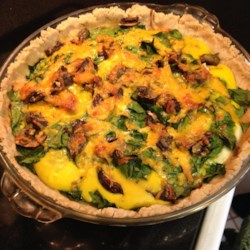 Quick Quiche Recipe - Refrigerated crescent dough makes a quick and tasty crust for this cheese, spinach, and red pepper filled quiche.
