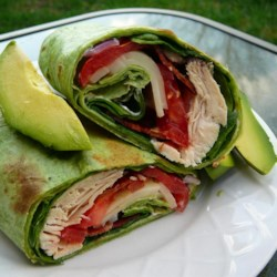 California Club Chicken Wraps Recipe - The classic California club sandwich is now featured as a wrap stuffed with bacon, lettuce, Monterey Jack cheese, avocado, chicken, tomato, onion, and a zesty chipotle mayonnaise.