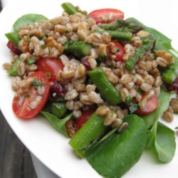 Farro Salad with Asparagus and Parmesan Recipe - The nutty flavor of farro grain balances with the salty Parmesan and tart cranberries in this tasty salad. Plan ahead, as the farro needs to soak overnight. If you can't find farro, substitute spelt or wheat berries.
