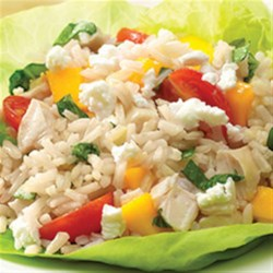 Mango Basil Chicken and Brown Rice Salad Recipe - Serve as a salad or even a wrap ... zippy balsamic vinaigrette, fresh basil and mango, with chicken and whole-grain brown rice.  Oh, and, don't forget the cheese.