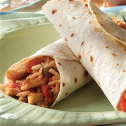 Chicken and Rice Burritos Recipe - Chunks of chicken, salsa, brown rice, and cheese make quick and delicious burritos for lunch or a hearty snack.