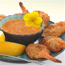 Baked Coconut Shrimp with Spicy Dipping Recipe - Butterflied shrimp dipped in coconut milk and coated with a panko and flaked coconut are baked until golden brown  and served with a zesty orange-mustard dipping sauce.