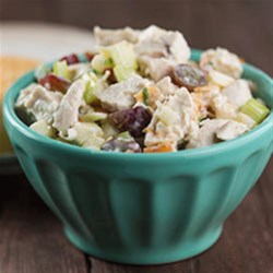 Toasted Coconut Chicken Salad Recipe - Chicken salad with chopped apple, celery, and grapes in a creamy Dijon mustard dressing is topped with toasted coconut and almonds.