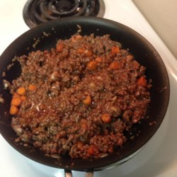 Healthier Sloppy Joes II Recipe - With more vegetables and real garlic, these sloppy joes just got a little healthier. Try serving this dish on whole wheat buns for added health benefits.