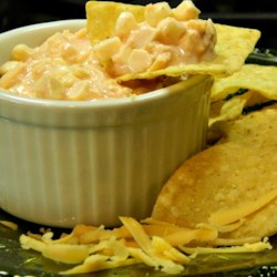 Corn Salsa Dip Recipe - Corn and salsa are folded with sour cream and Cheddar cheese creating a simple and crowd-pleasing corn salsa dip.