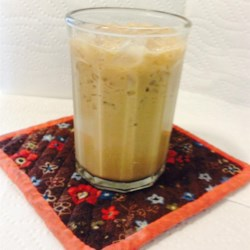 Creamy Ice Coffee Recipe - Cold coffee mixed with milk, half-and-half, and chocolate liqueur. Serve over ice.