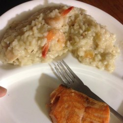 Seafood Risotto Recipe - Creamy, flavorful seafood risotto with clams and cooked salmon. Clam juice really lets the seafood flavor shine through! It's a great way to use up leftover salmon.